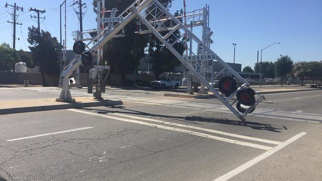 Dump truck hits railroad signal at Peach & McKinley   KMPH